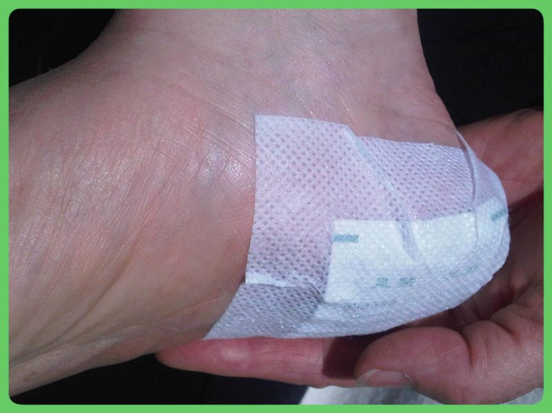 A foot patch applied onto the heel